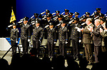WATERBURY, CT-012318JS23--Police recruits salute the flag during graduation exercises for the Waterbury Police Department and Waterbury Police Academy's class 2017-01 Tuesday at the Palace Theater in Waterbury. 29 new officers were sworn in during the event. <br /> Jim Shannon Republican-American