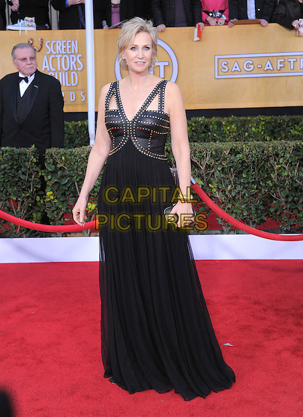 Jane Lynch.Arrivals at the 19th Annual Screen Actors Guild Awards at the Shrine Auditorium in Los Angeles, California, USA..27th January 2013.SAG SAGs full length black dress leather studs studded .CAP/DVS.©DVS/Capital Pictures.
