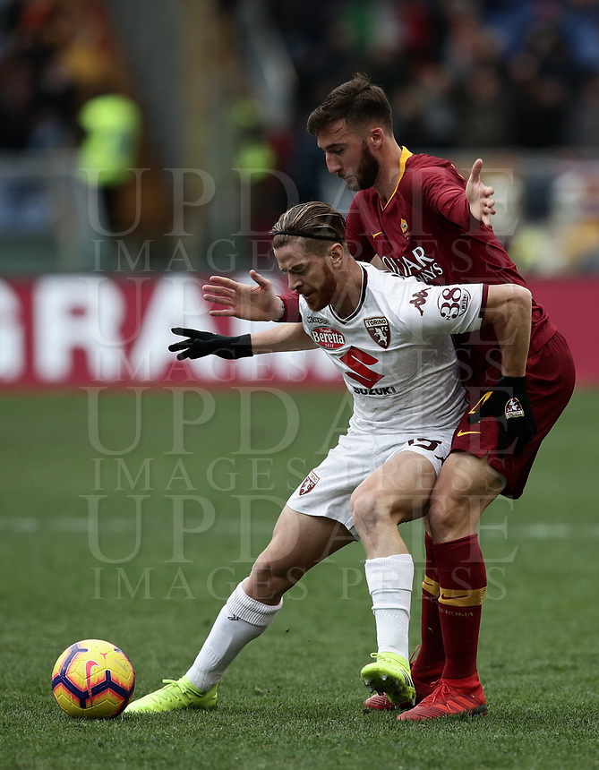Football, Serie A: AS Roma - Torino, Olympic stadium, Rome, January 19, 2019. <br /> Torino's Cristian Daniel Ansaldi (l) in action with Roma's Bryan Cristante (r) during the Italian Serie A football match between AS Roma and Torino at Olympic stadium in Rome, on January 19, 2019.<br /> UPDATE IMAGES PRESS/Isabella Bonotto