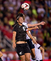 Abby Wambach (20) of the USWNT goes up for a header with Abby Erceg (5) of New Zealand during an international friendly at Crew Stadium in Columbus, OH. The USWNT tied New Zealand, 1-1.