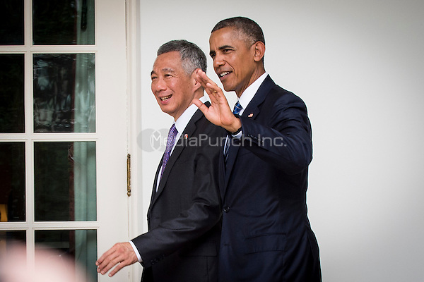United States President Barack Obama and Prime Minister Lee Hsien Loong of Singapore make their way to the Oval Office for a meeting following a State Welcome Ceremony on the South Lawn of the White House in Washington, DC on August 2, 2016. Lee is on a State Visit to the United States. <br /> Credit: Pete Marovich / Pool via CNP/MediaPunch