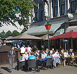 People sitting outside bar in sunshine, Rotterdam, South Holland, Netherlands