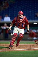Clearwater Threshers catcher Austin Bossart (8) tracks down a loose ball during the second game of a doubleheader against the Palm Beach Cardinals on April 13, 2017 at Spectrum Field in Clearwater, Florida.  Palm Beach defeated Clearwater 1-0.  (Mike Janes/Four Seam Images)