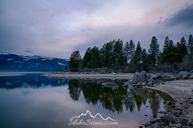 Idaho, West Central, Cascade. Lake Cascade and the Crown Point Unit of Lake Cascade State Park at dusk in spring.