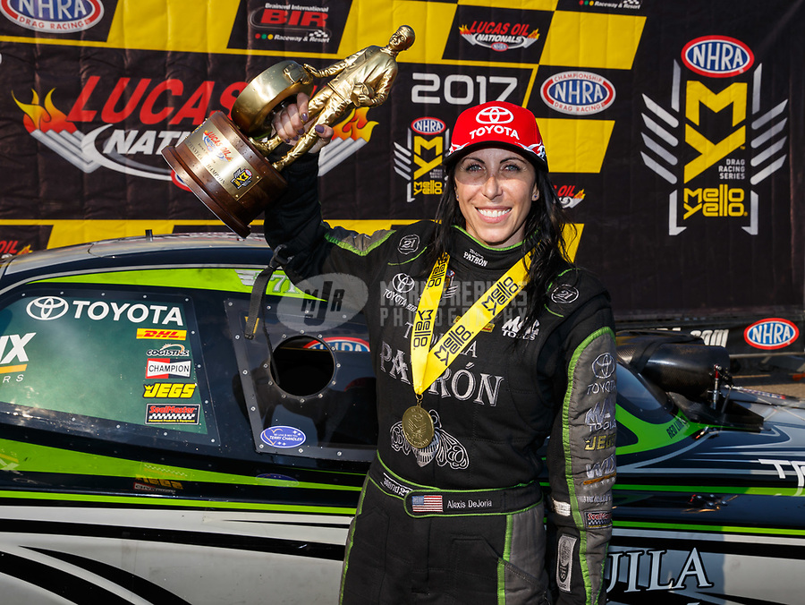 Aug 20, 2017; Brainerd, MN, USA; NHRA funny car driver Alexis DeJoria celebrates after winning the Lucas Oil Nationals at Brainerd International Raceway. Mandatory Credit: Mark J. Rebilas-USA TODAY Sports