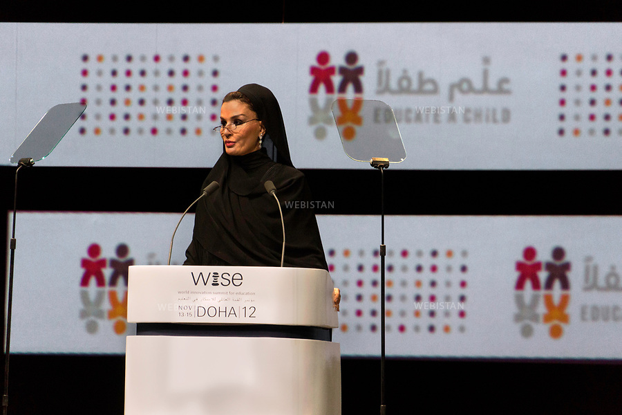 Qatar, Doha, Qatar National Convention Centre <br /> Opening speech of the World Innovation Submit for Education 2012 (WISE): portrait of Sheikha Mozah bint Nasser Al Missned, second of the three wives of Sheikh Hamad bin Khalifa Al Thani, former Emir of the State of Qatar, from 1995 to 2013 and mother of the current emir, Sheikh Tamim bin Hamad Al Thani. <br /> Founder of the Qatar foundation for education founded in 1996, she presides at the Foundation's annual convention every year. Named UNESCO Special Envoy for Basic &amp; Higher Education in 2013, she oversees all Qatari reforms related to education and the Family Law adopted in 2006 in Qatar. <br /> Qatar is one of the Arab peninsular emirates, on the Persian Gulf shoreline. Bordered by Saudi Arabia, Qatar's economy relies on oil and gas. Being the world's fourth-largest gas exporter, gas remains the major driver of Qatar's economy. The emirate is governed by Sheikh Tamim bin Hamad Al Thani who became at the age of 33 Emir of Qatar on 25 June 25th, 2013 after his father's abdication. He is the youngest emir at the head of an Arab State.<br /> On June 5th, 2017, Saudi Arabia, the United Arab Emirates, Egypt, Bahrain, Yemen, Libya, Mauritania, the Maldives, and Mauritius broke off diplomatic relations with Qatar, accusing the emirate of supporting several terrorist groups. As its Gulf neighbours enforced the closure of all land, air and sea borders to Qatar, the country is quarantined.<br /> 