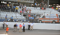 Apr 26, 2009; Talladega, AL, USA; NASCAR Sprint Cup Series officials survey the damage to the catch fence after a last lap crash the Aarons 499 at Talladega Superspeedway. Mandatory Credit: Mark J. Rebilas-