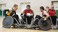 27 MAY 2013 - DONCASTER, GBR - Stephen Hickey (second from left) of the Solent Sharks finds his path to goal blocked by Alan Lynch (left) and Ger Scully (right) of the Gaelic Warriors during the 2013 Great Britain Wheelchair Rugby Nationals at The Dome in Doncaster, South Yorkshire (PHOTO (C) 2013 NIGEL FARROW)