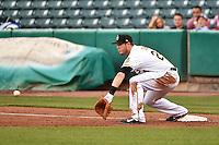 C.J. Cron (24) of the Salt Lake Bees on defense against the Fresno Grizzlies at Smith's Ballpark on April 9, 2014 in Salt Lake City, Utah.  (Stephen Smith/Four Seam Images)