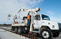 Dallas Area Rapid Transit workers pull wires and hang hangars at a new light rail transit stop for the new Green Line in Carrollton, Texas, USA, Thursday, Dec., 3, 2009. The City of Dallas hopes plans to open the new line in 2010...MATT NAGER/ BLOOMBERG NEWS