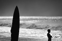 Surfer Standing on the Beach Looking at Waves