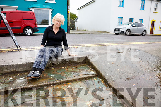 Eileen Wheelan outside her property in Portmagee where water has been flowing from a water meter for the last 5 months that no one seems to be in any hurry to fix.