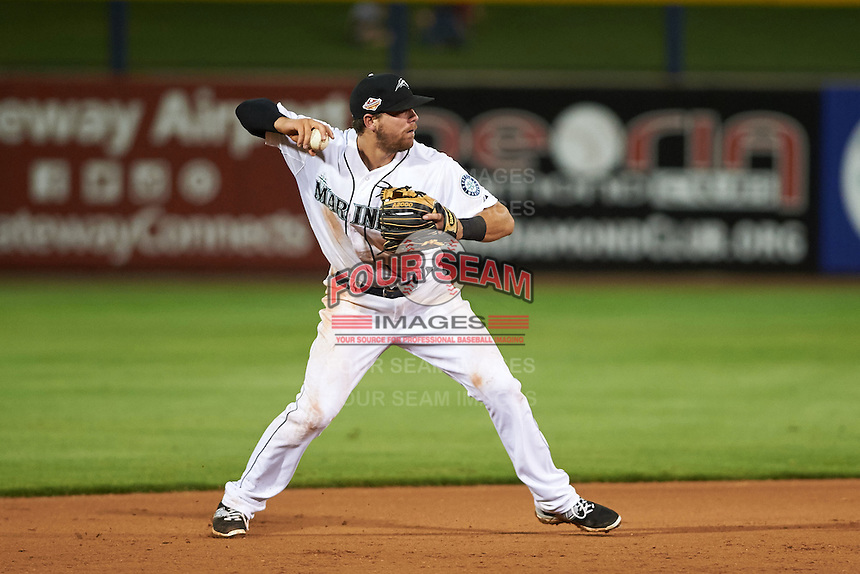Peoria Javelinas shortstop Tyler Smith (13) throws to first during an Arizona Fall League game against the Glendale Desert Dogs on October 19, 2015 at Peoria Stadium in Peoria, Arizona.  Glendale defeated Peoria 4-2.  (Mike Janes/Four Seam Images)