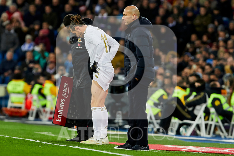 Gareth Bale (L) and Zinedine Zidane (R) coach of Real Madrid during La Liga match between Real Madrid and Real Sociedad at Santiago Bernabeu Stadium in Madrid, Spain. November 23, 2019. (ALTERPHOTOS/A. Perez Meca)