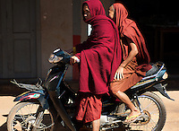 Two monks at the Nang Yone Monastery near Hsipaw set off together on a moped.