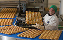 23/03/16<br /> <br /> ***FILE PHOTO***<br /> <br /> Hot cross buns being made for M&amp;S at Gunstones Bakery near Chesterfield, Derbyshire.<br /> <br />  <br /> M&amp;S prepares for bun fights at the tills as it expects to sell 1000 hot cross a minute.<br /> <br /> M&amp;S expects to sell 1000 hot cross buns a minute over the Easter bank holiday.<br /> <br /> The retailer sells a third of the nation&rsquo;s hot cross buns at Easter, and expects to sell over 30 million this Easter. <br /> <br /> The retailer&rsquo;s hot cross bun supplier is already in 24 hour production to meet customer demand.<br /> <br /> M&amp;S has its largest ever range of hot cross buns this year to excite customers taste buds.<br /> Over the Easter period thirty tons of flour and twenty tons of fruit are used to make a quarter of a million buns every day. <br />  <br /> M&amp;S will sell enough buns that if laid end-to-end, they'd stretch from the supplier in Sheffield to Nazareth.<br /> During Easter week the retailer will sell enough individual hot cross buns that if stacked could scale Mount Everest 14 times.<br />  <br />  <br /> <br /> All Rights Reserved: F Stop Press Ltd. +44(0)1335 418365   www.fstoppress.com.
