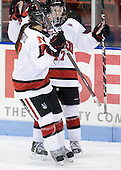Brittany Esposito (Northeastern - 7), Kendall Coyne (Northeastern - 77) - The Northeastern University Huskies defeated the visiting Clarkson University Golden Knights 5-2 on Thursday, January 5, 2012, at Matthews Arena in Boston, Massachusetts.