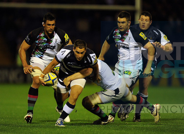 Matty James of Sale Sharks tackled by Tom Guest of Harlequins