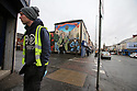 A man walks past a Pro British Loyalist mural on the Shankill Road, west Belfast, Tuesday, April 10th, 2018. Tuesday marks 20 years since politicians from Northern Ireland and the British and Irish governments agreed what became known as the Good Friday Agreement. It was the culmination of a peace process which sought to end 30 years of the Troubles. Two decades on, the Northern Ireland Assembly is suspended in a bitter atmosphere between the two main parties. Photo/Paul McErlane