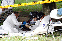 Colombian forensic workers dig the remains of a victim of the violence as The Prosecutor's Office reports that it has recovered the remains of 120 missing victims in the hope that their relatives will claim them in Medellin, on June 5, 2017.  Photo by VIEWpress/Camilo Mejia