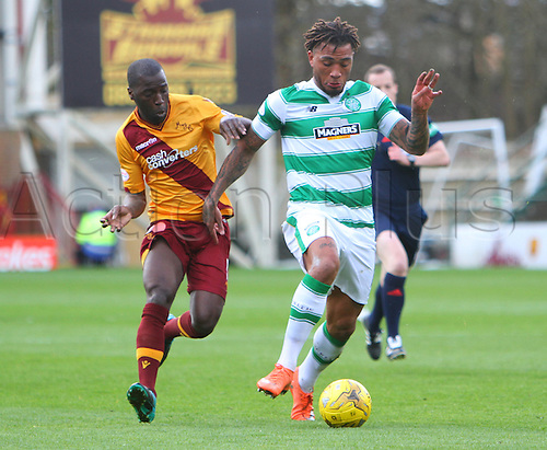 09.04.2016. Fir Park, Motherwell, Scotland. Scottish Football Premiership Motherwell versus Celtic. Colin Kazim-Richards takes the ball forward with Morgaro Gomis in close chase
