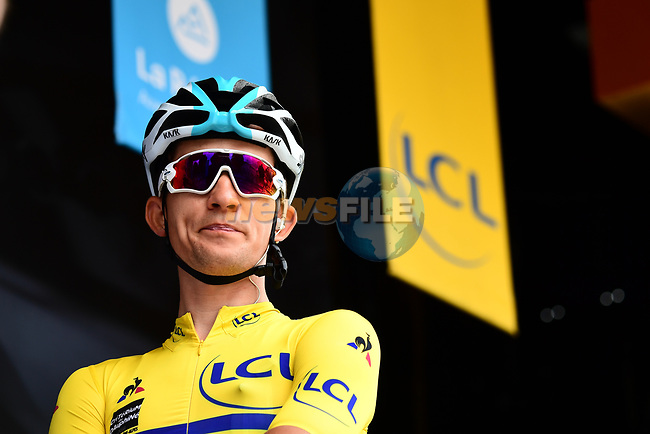 Race leader Michal Kwiatkwoski (POL) Team Sky Maillot Jeune at sign on before the start of Stage 2 of the 2018 Criterium du Dauphine 2018 running 181km from Montbrison to Belleville, France. 5th June 2018.<br /> Picture: ASO/Alex Broadway | Cyclefile<br /> <br /> <br /> All photos usage must carry mandatory copyright credit (© Cyclefile | ASO/Alex Broadway)