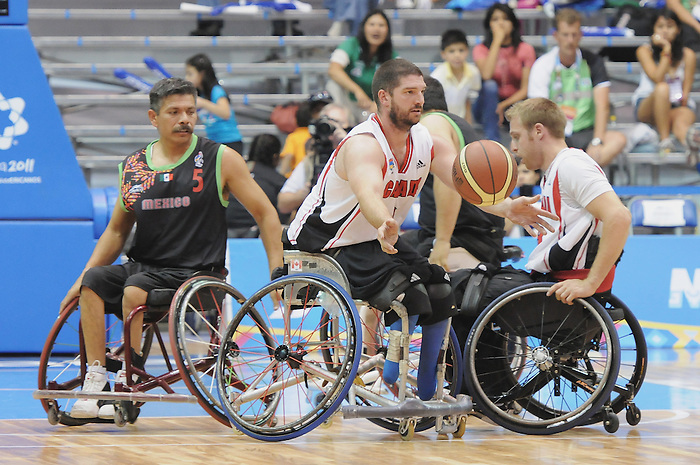 November 18 2011 - Guadalajara, Mexico:   Adam Lancia of Team Canada reaches for the ball in the CODE Alcalde Sports Complex at the 2011 Parapan American Games in Guadalajara, Mexico.  Photos: Matthew Murnaghan/Canadian Paralympic Committee