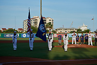 United States Navy flag presentation before a Pensacola Blue Wahoos Southern League game against the Biloxi Shuckers on May 3, 2019 at Admiral Fetterman Field in Pensacola, Florida.  Pensacola defeated Biloxi 10-8.  (Mike Janes/Four Seam Images)