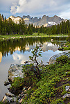 Wind River Range, WY: Reflections from Horseshoe Lake with Cirque of the Towers in the distance; Lizard Head Meadows; Popo Agie Wilderness in the Bridger National Forest in summer