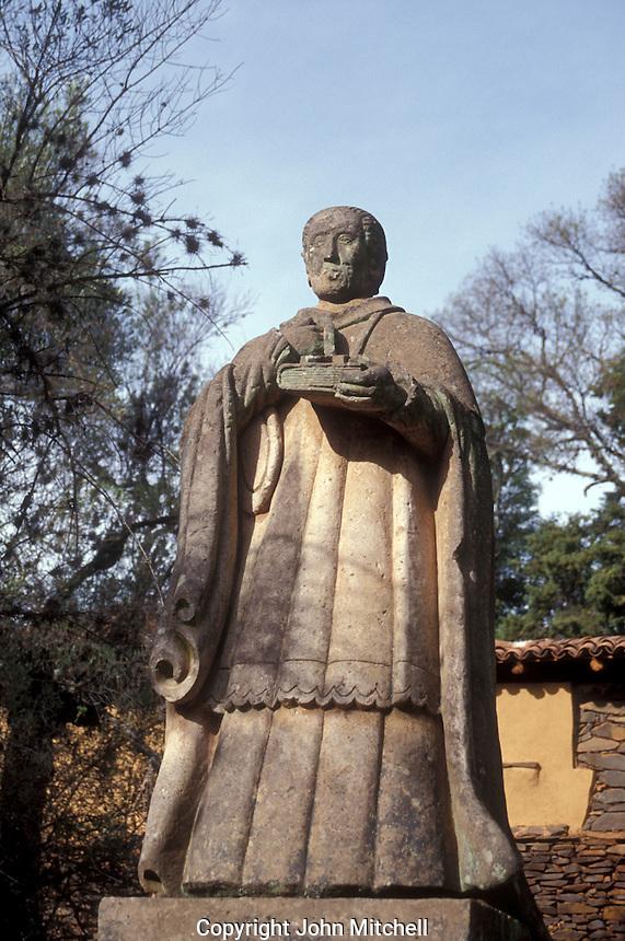 Statue of Bishop Vasco de Quiroga on the grounds of the Ex Convento de San Francisco in Tzintzuntzan on Lake Patzcuaro, Michoacan, Mexico. Vasco de Quiroga established village cooperatives established on the Utopian ideas of Sit Thomas More.
