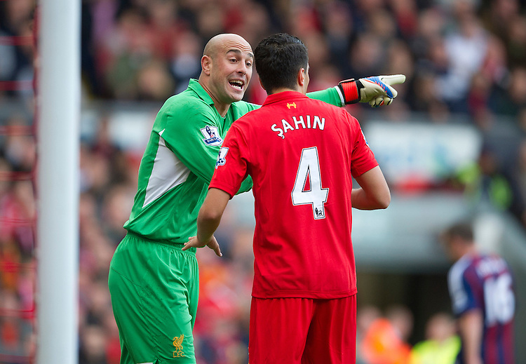 Liverpool's Pepe Reina remonstrates with with his team-mate Nuri Sahin  for not clearing a danger..Football - Barclays Premiership - Liverpool v Stoke City - Sunday 7th October 2012 - Anfield - Liverpool..