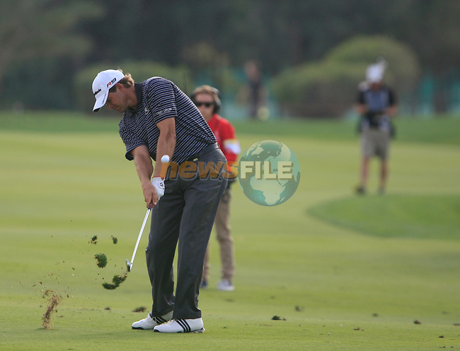 Retief Goosen plays his 2nd shot on the 13th hole during Thusday Day 1 of the Abu Dhabi HSBC Golf Championship, 20th January 2011..(Picture Eoin Clarke/www.golffile.ie)