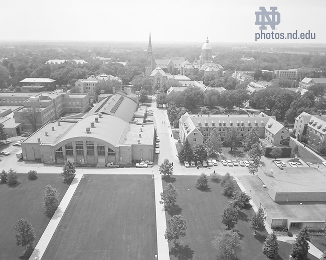 GPHR 45/0001:  View of campus from the Hesburgh Library, including the Fieldhouse, Center for Social Concerns building, Breen-Phillips Hall, Washington Hall, Basilica of the Sacred Heart, and Main Building, 1967..Image from the University of Notre Dame Archives.