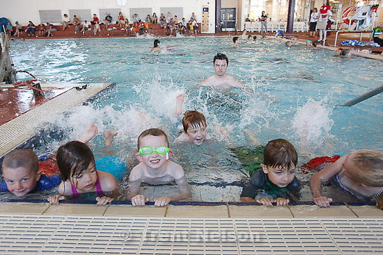 Trent Nelson  |  The Salt Lake Tribune.Kids in instructor Michael Watson's Pre-School Aquatics 3 class work on their kicks during an attempt at a world record for the largest swim lesson at the Clearfield Aquatic Center in Clearfield, Utah, Tuesday, June 14, 2011.