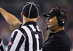 Washington's head coach Steve Sartisian questions an official's call in a college football game against San Diego State at CenturyLink Field in Seattle, Washington on September 1, 2012  The Huskies beat the Aztecs 21-12.  © 2012. Jim Bryant Photo. All Rights Reserved.