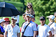 Bethesda, MD - July 1, 2018: A young fan dressed in a Tiger suite watches Tiger Woods tee off during final round of professional play at the Quicken Loans National Tournament at TPC Potomac at Avenel Farm in Bethesda, MD.  (Photo by Phillip Peters/Media Images International)