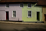 Colourful pastel coloured old cottage in New Street, Woodbridge, Suffolk, England