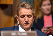 United States Senator Jeff Flake (Republican of Arizona) listens as the US Senate Committee on the Judiciary meets to vote on the nomination of Judge Brett Kavanaugh to be Associate Justice of the US Supreme Court to replace the retiring Justice Anthony Kennedy on Capitol Hill in Washington, DC on Friday, September 28, 2018.  If the committee votes in favor of Judge Kavanaugh then it goes to the full US Senate for a final vote.<br /> Credit: Ron Sachs / CNP<br /> (RESTRICTION: NO New York or New Jersey Newspapers or newspapers within a 75 mile radius of New York City)