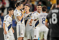 CARSON, CA - SEPTEMBER 21: Zlatan Ibrahimovic #9 and Daniel Steres #5 of the Los Angeles Galaxy have a few words while celebrating during a game between Montreal Impact and Los Angeles Galaxy at Dignity Health Sports Park on September 21, 2019 in Carson, California.