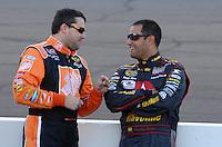 Apr 19, 2007; Avondale, AZ, USA; Nascar Nextel Cup Series driver Tony Stewart (20) talks with Juan Pablo Montoya (42) during qualifying for the Subway Fresh Fit 500 at Phoenix International Raceway. Mandatory Credit: Mark J. Rebilas
