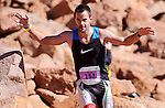 August 15, 2015 - Manitou Springs, Colorado, U.S. - Lakewood, Colorado runner, Brian Folts, acknowledges the crowd as he completes the Pikes Peak Ascent during the 60th running of the Pikes Peak Ascent and Marathon.  During the Ascent, runners cover 13.3 miles and gain more than 7815 feet (2382m) by the time they reach the 14,115ft (4302m) summit.  On the second day of race weekend, 800 marathoners will make the round trip and cover 26.6 miles of high altitude and very difficult terrain in Pike National Forest, Manitou Springs, CO.