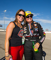 Apr 12, 2015; Las Vegas, NV, USA; NHRA pro stock driver Erica Enders-Stevens (right) celebrates with sister Courtney Enders after winning the Summitracing.com Nationals at The Strip at Las Vegas Motor Speedway. Mandatory Credit: Mark J. Rebilas-