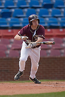 Garret Smith #4 of the Boston College Eagles follows through on his swing versus the Wake Forest Demon Deacons at Wake Forest Baseball Park April 11, 2009 in Winston-Salem, NC. (Photo by Brian Westerholt / Four Seam Images)