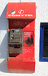 Old disused broken Comytel public telephone booth phone, Almeria, Spain