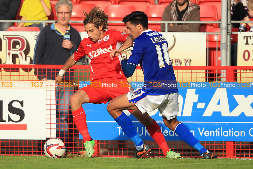 Sergio Torres of Crawley Town comes under pressure from Matteo Lanzoni of Oldham Athletic - Crawley Town vs Oldham Athletic - Sky Bet League One Football at the Broadfield Stadium Crawley, West Sussex - 28/09/13 - MANDATORY CREDIT: Simon Roe/TGSPHOTO - Self billing applies where appropriate - 0845 094 6026 - contact@tgsphoto.co.uk - NO UNPAID USE