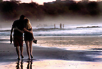 A couple walking on the main beach in Tamarindo Costa Rica.