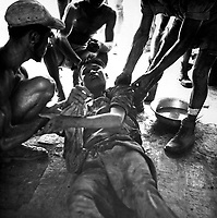 A wounded Vietminh prisoner is given first aid by Franco Vietnamese medicals after hot fire fight near Hung Yen, south of Hanoi.  Ca.  1954  (USIA)<br /> EXACT DATE SHOT UNKNOWN<br /> NARA FILE #:  306-PS-54-11793<br /> WAR &amp; CONFLICT BOOK #:  384