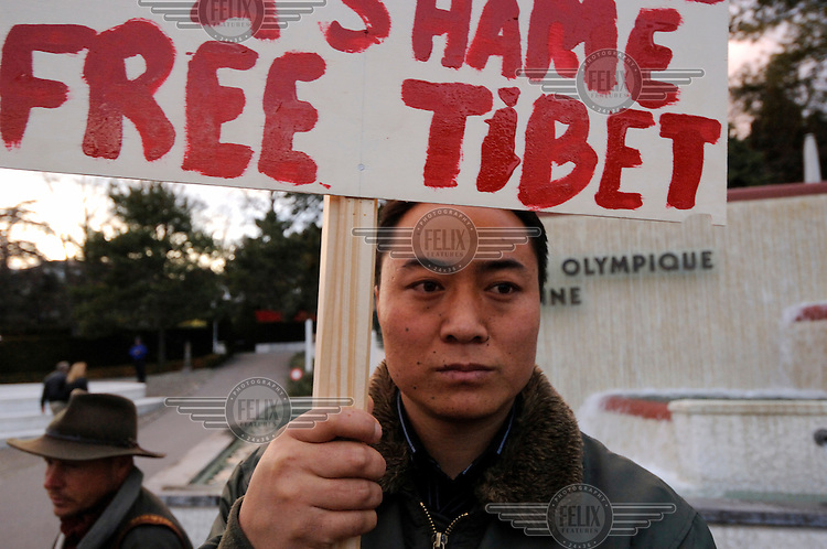Tibetan demonstrator at a demonstation calling for a boycott of the opening ceremony, and lighting of the Olympic flame, for the 2008 Beijing Olympic Games. Switzerland is home not only to the head quarters of the International Olympic Committee, but also to Europe's largest Tibetan refugee community.