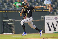 Omaha Storm Chasers outfielder Justin Maxwell (46) rounds third base during the Pacific Coast League baseball game against the Round Rock Express on June 1, 2014 at the Dell Diamond in Round Rock, Texas. The Express defeated the Storm Chasers 11-4. (Andrew Woolley/Four Seam Images)