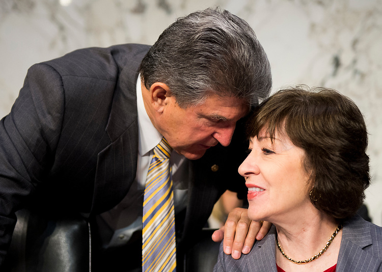 "UNITED STATES - MAY 11: Sen. Joe Manchin, D-W. Va.,  and Sen. Susan Collins, R-Maine, talk before the start of the Senate (Select) Intelligence Committee hearing on ""World Wide Threats"" on Thursday, May 11, 2017. (Photo By Bill Clark/CQ Roll Call)"